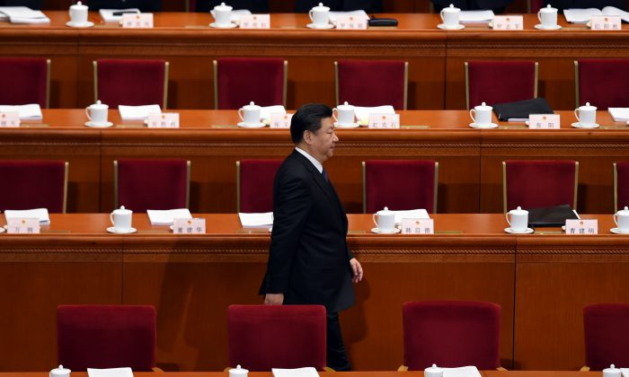 Chinese leader Xi Jinping arrives for the opening ceremony of the National People's Congress in the Great Hall of the People in Beijing on March 5, 2016. (WANG ZHAO/AFP/Getty Images)