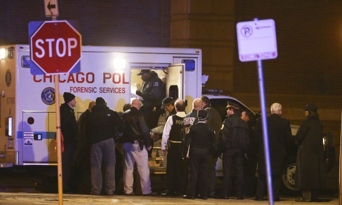 Members of the Chicago Police Department investigate the scene of a shooting in the 3700 block of West Polk Street in the Homan Square neighborhood in Chicago on Monday, March 14, 2016. Three officers were shot and one suspect was killed at the scene. The officers were rushed to Stroger Hospital for treatment of injuries that are not life-threatening, according to police spokesman Anthony Guglielmi. (Nuccio DiNuzzo/Chicago Tribune via AP) MANDATORY CREDIT, CHICAGO SUN-TIMES OUT, DAILY HERALD OUT, NORTHWEST HERALD OUT, DAILY CHRONICLE OUT, THE HERALD-NEWS OUT, THE TIMES OF NORTHWEST INDIANA OUT, TV OUT, MAGS OUT, NO SALES
