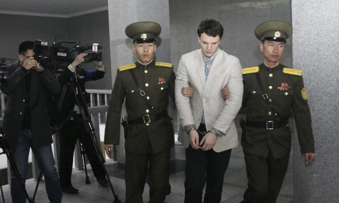 American student Otto Warmbier, center, is escorted at the Supreme Court in Pyongyang, North Korea on March 16, 2016,. (AP Photo/Jon Chol Jin)