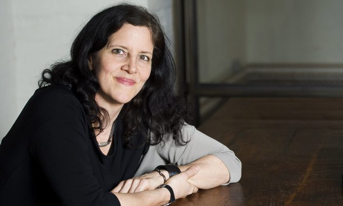 "FILE - In this April 16, 2014 file photo, Laura Poitras poses for a portrait in New York.  Poitras has a solo exhibition titled, ""Astro Noise,"" showing at the Whitney Museum of American Art through May 1. (Photo by Charles Sykes/Invision/AP, File)"