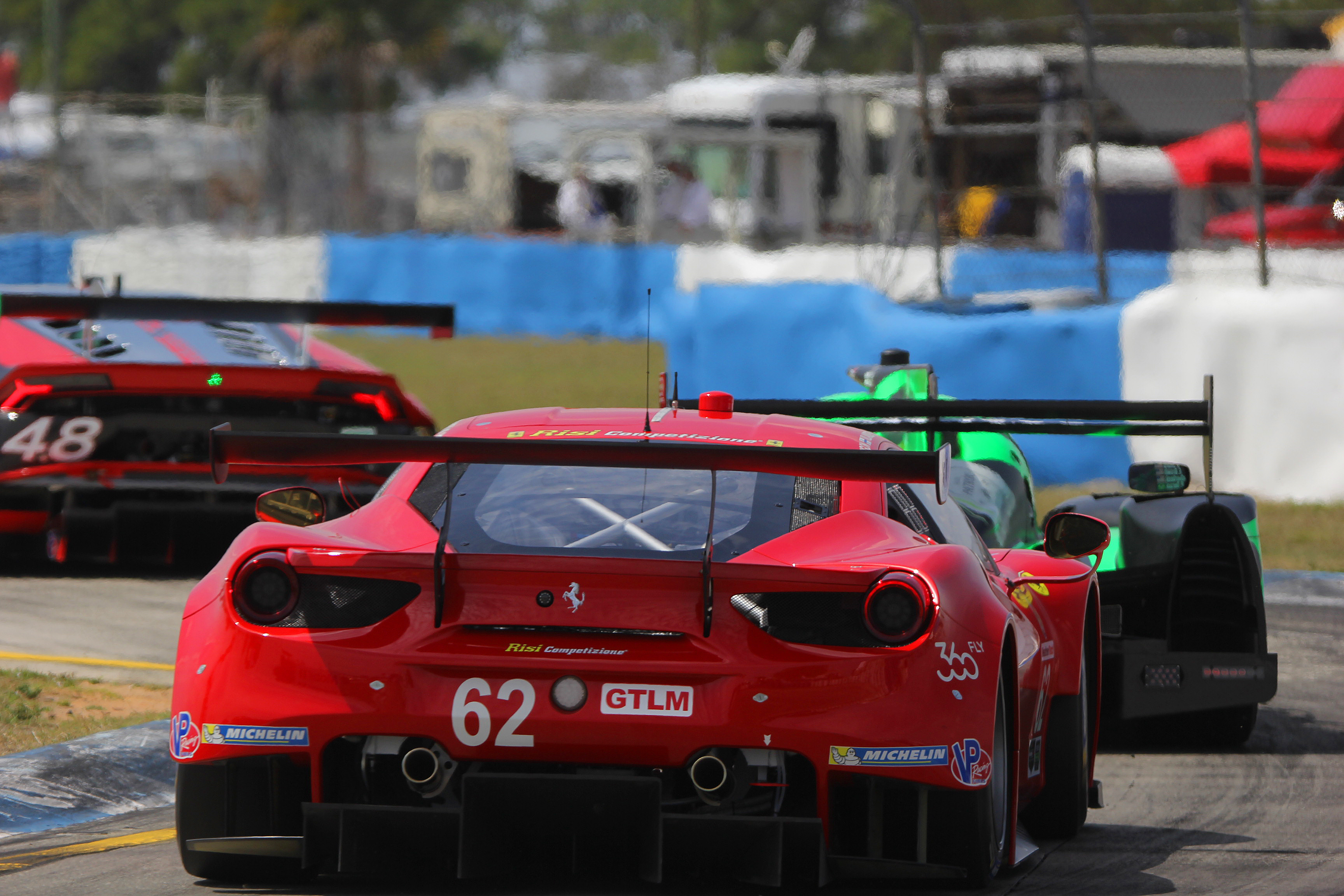 The 62 gtlm risi ferrari 488 chases the 2 p esm ligier honda