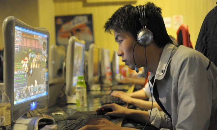 A chinese man plays online games at an internet cafe in Beijing on February 27, 2010. (LIU JIN/AFP/Getty Images)