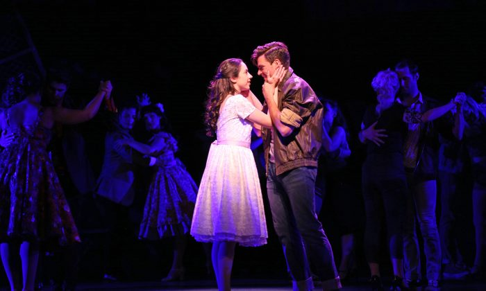 "Maria (Zoe Nadal) and Tony (Will Skrip) meet and instantly fall in love, in ""West Side Story."" (Liz Lauren)"