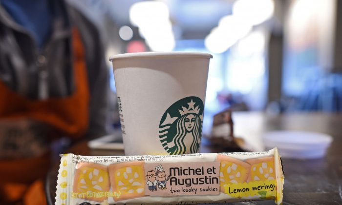 """A package of """"Michel et Augustin two kooky cookies"""" sits next to a Starbucks coffee cup in a Starbucks  in Brooklyn January 6, 2016 in New York.(DON EMMERT/AFP/Getty Images)"""
