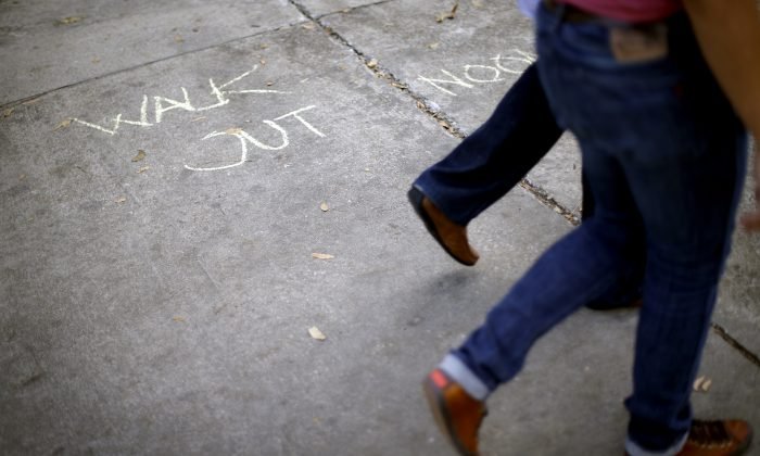 A chalk message outside the administrative offices at Emory University, Tuesday, Dec. 4, 2012. (AP Photo/David Goldman)