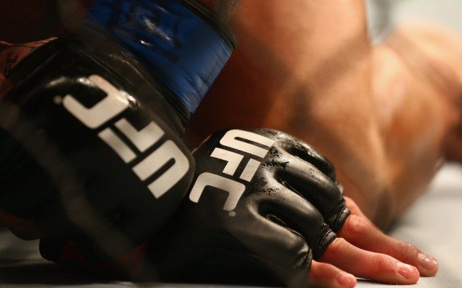A detail of gloves worn by UFC fighters Anthony Pettis and Rafael dos Anjos in the Lightweight Title bout during the UFC 185 event at American Airlines Center on March 14, 2015 in Dallas, Texas.  (Ronald Martinez/Getty Images)