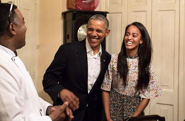 At a restaurant in Old Havana, Malia and President Obama laugh as she translates from Spanish to English. (Pete Souza/White House)