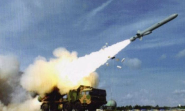 A long-range anti-ship missile is shown being fired, allegedly on Woody Island in the South China Sea. The image appeared in a blog post on China's Weibo, and could show a new development of the Chinese regime's weaponization of the disputed islands. (Weibo, via IHS Jane's)