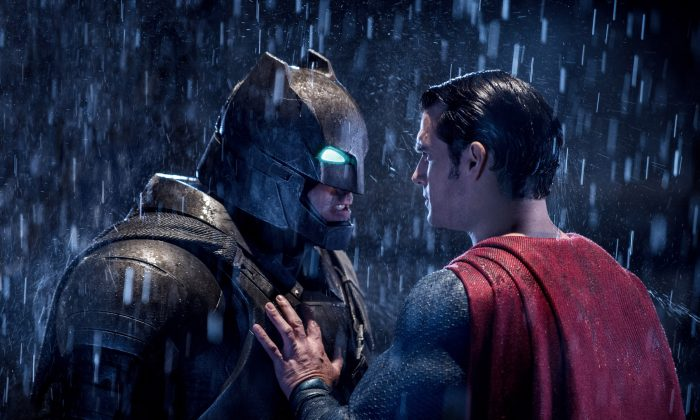 """This image released by Warner Bros. Entertainment shows Ben Affleck as Batman (L) and Henry Cavill as Superman in a scene from, """"Batman V. Superman: Dawn Of Justice."""" (Clay Enos/Warner Bros. Entertainment via AP)"""