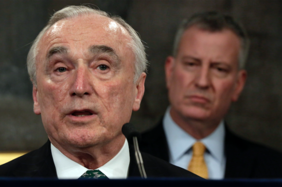 New York City Police Commissioner William Bratton, left, speaks during a news conference in New York's City Hall, as New York Mayor Bill de Blasio listens, Tuesday, Jan. 12, 2016. (Richard Drew/AP)
