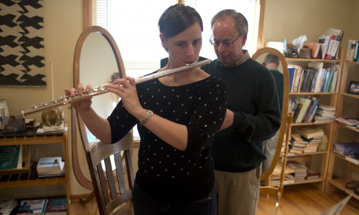 Robert Rickover uses the Alexander Technique to help a flute player. (Courtesy of Robert Rickover)