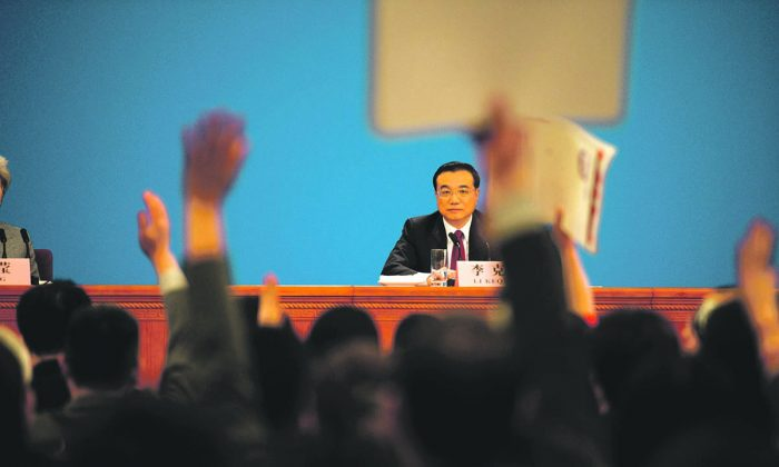Chinese Premier Li Keqiang takes questions from journalists during the press conference after the closing session of the National People's Congress in the Great Hall of the People in Beijing on March 16, 2016. (Fred Dufour/AFP/Getty Images)
