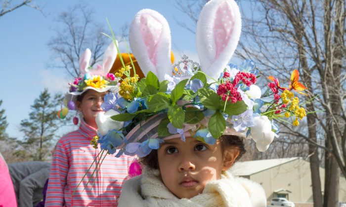 Olivia Figueroa walks in the bonnet parade during the Wallkill Easter Egg Hunt in Circleville Park on March 26, 2016. (Holly Kellum/Epoch Times)