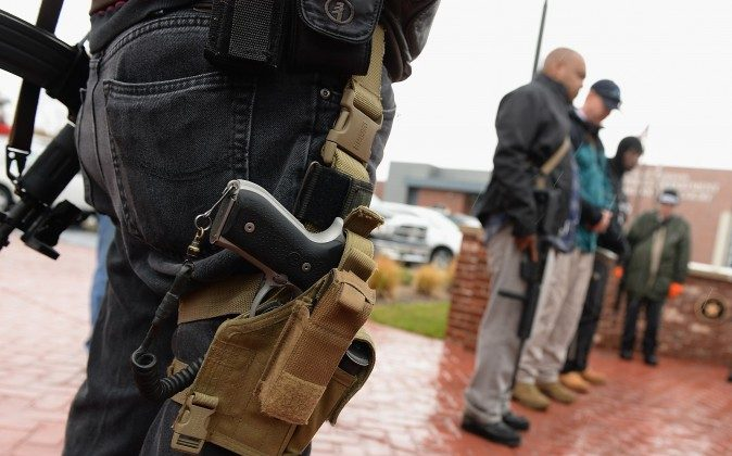Open carry gun activists participate in a march in Ferguson, Mo., on Nov. 16, 2015. (Michael B. Thomas/AFP/Getty Images)