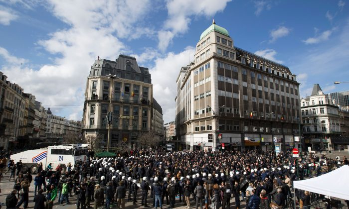 Anti-riot police officers surround right wing demonstrators who disturbed a tribute to the victims of terror attacks on Place de la Bourse in Brussels on March 27, 2016. (Kristof Van Accom/AFP/Getty Images)