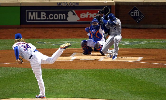 Alcides Escobar (R) of the Kansas City Royals is brushed back by a pitch from Noah Syndergaard  of the New York Mets in the first inning of Game 3 of the 2015 World Series. (Elsa/Getty Images)