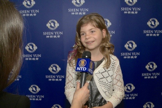 Emma Holzleitner was immersed in the Shen Yun Orchestra music at the Grosses Festspielhaus. (Courtesy of NTD Television)