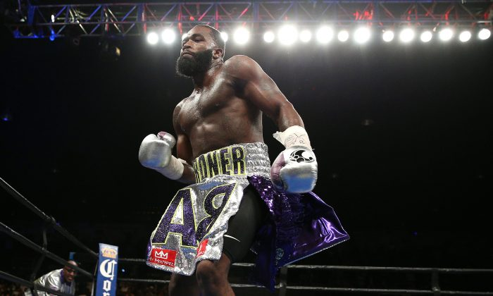 Adrien Broner celebrates after defeating Ashley Theophane (not pictured) by TKO in ninth round in their super lightweight championship bout at the DC Armory on April 1. (Patrick Smith/Getty Images)