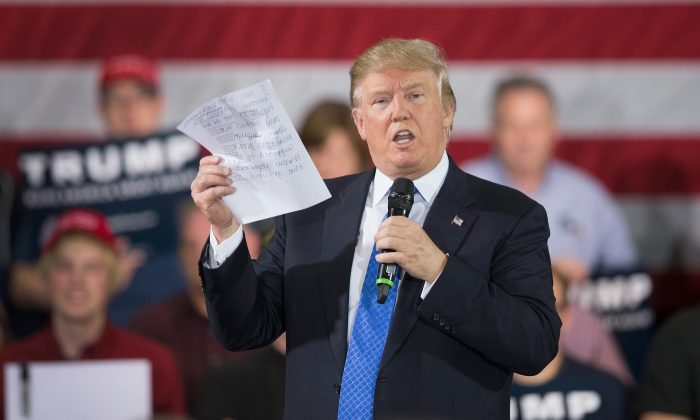 During a campaign rally Republican presidential candidate Donald Trump reads a statement made by Michelle Fields, a former reporter for Breitbart News Service who alleges that Trump's campaign manager Corey Lewandowski assaulted her at a recent press conference, on March 29, 2016 in Janesville, Wisconsin. (Photo by Scott Olson/Getty Images)