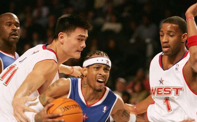 China's Yao Ming (L) of the Western Conference team defends against Allen Iverson (C) of the Eastern Conference as the West's Tracy McGrady (R) and the East's Shaquille O'Neal (far L) look on during the NBA All-Star game 20 February 2005 in Denver. Iverson was named Most Valuable Player (MVP) of the game as the East won 125-115. (DON EMMERT/AFP/Getty Images)