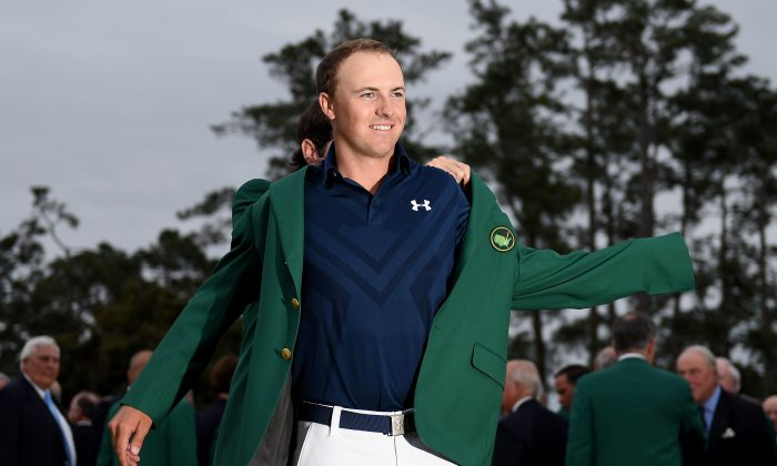 Jordan Spieth is presented with his Green Jacket after the final round of the 2015 Masters at Augusta National Golf Club. (Ross Kinnaird/Getty Images)