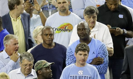 63cd017a9d71 Former North Carolina and NBA star Michael Jordan watches the championship  game between Villanova and North