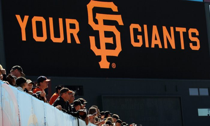 Baseball fans watch batting practice before the start of the San Francisco Giants home opener against the St. Louis Cardinals at AT&T Park on April 8, 2011 in San Francisco, California. (Justin Sullivan/Getty Images)