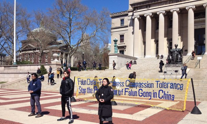 Practitioners of Falun Gong demonstrate the meditative exercises on Columbia University's campus on April 5, 2016. (Leo Timm/Epoch Times)