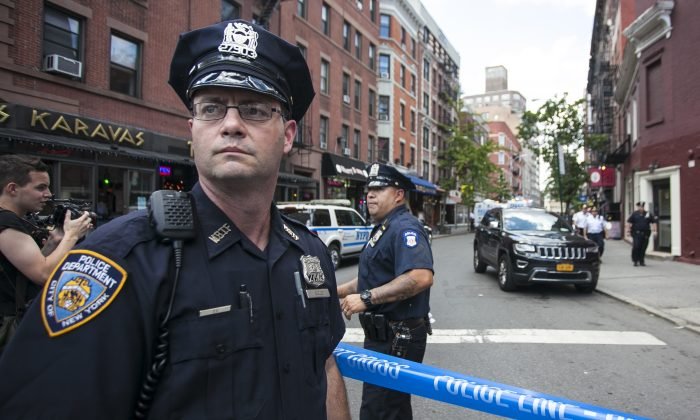 Police at a crime scene after a shootout occurred that ultimately left the suspect dead in the West Village of Manhattan on  July 28, 2014. (Samira Bouaou/Epoch Times)