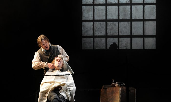 Rod Gilfry (L) and John Graham-Hall perform respectively as Sweeney Todd and Beadle Bamford on April 19, 2011 at the Chatelet Theatre in Paris. (Mehdi Fedouach/AFP/Getty Images)