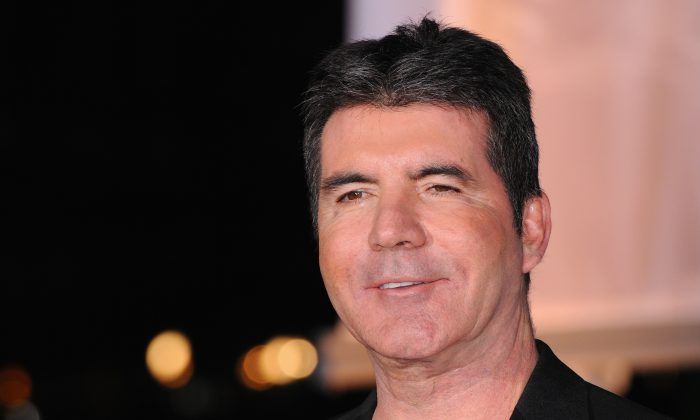 Simon Cowell attends A Night Of Heroes: The Sun Military Awards at National Maritime Museum on December 10, 2014 in London, England.  (Photo by Eamonn M. McCormack/Getty Images)
