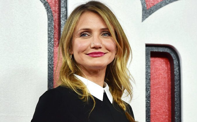 US actress Cameron Diaz poses for pictures during a photocall for the film 'Annie' in central London on December 16, 2014. (BEN STANSALL,BEN STANSALL/AFP/Getty Images)