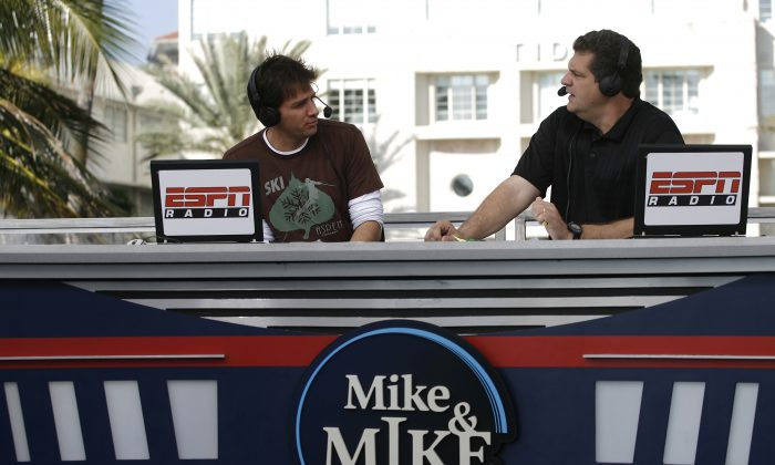 Mike Greenberg (L) and Mike Golic during their ESPN Radio show, Mike & Mike in the Morning, broadcast on the ESPN set in Miami, Florida on February 1, 2007. (Allen Kee/Getty Images)
