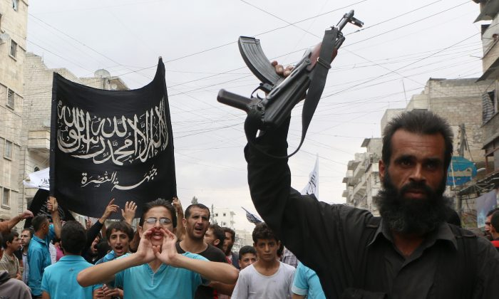 Supporters of the Nusra Front, an al-Qaeda affiliate, take part in a protest against Syrian President Bashar al-Assad and the international coalition in Aleppo on Sept. 26, 2014. Al-Qaeda and ISIS are competing for influence over the global jihadist movement. (Fadi al-Halabi/AFP/Getty Images)