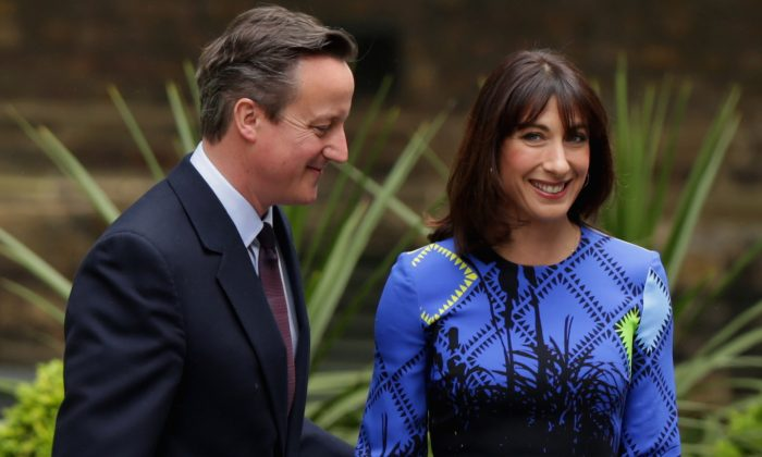 Prime Minister David Cameron (L) and his wife Samantha arrive at 10 Downing Street after returning from Buckingham Palace for a meeting with Queen Elizabeth II on May 8, 2015 in London, United Kingdom. (Photo by Chip Somodevilla/Getty Images)