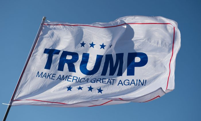 A Donald Trump campaign flag waves outside a Trump rally at Millington Regional Jetport on February 27, 2016 in Millington, Tennessee. (MICHAEL B. THOMAS/AFP/Getty Images)