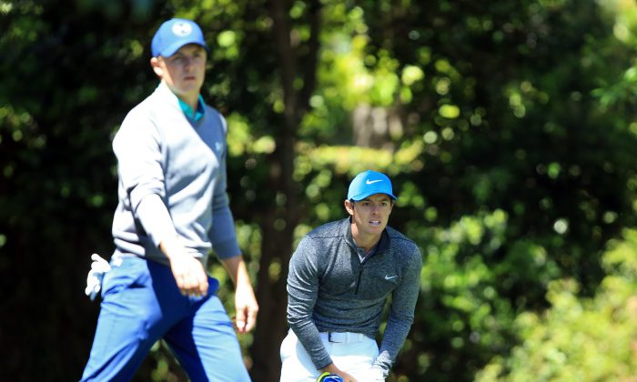 Rory McIlroy (R) reacts to his shot from the second tee as Jordan Spieth of the United States walks from the tee during the third round of the 2016 Masters Tournament at Augusta National Golf Club in Augusta, Georgia. (David Cannon/Getty Images)