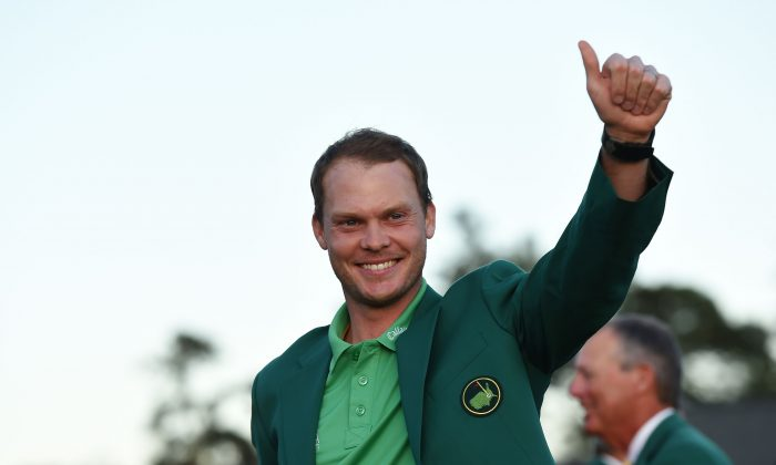 England's Danny Willett waves wearing his Green Jacket at the end of the 80th Masters Golf Tournament at the Augusta National Golf Club on April 10 in Augusta, Georgia. (Don Emmert/AFP/Getty Images)