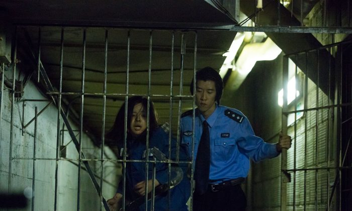 """A still from the film """"Bleeding Edge,"""" shows Chen Jing, played by Anastasia Lin, imprisoned in China for her belief in Falun Gong. The film from Peabody Award-winning director Leon Lee premiers at the Palm Beach International Film Festival on April 11. (Courtesy of Floating Cloud Productions)"""