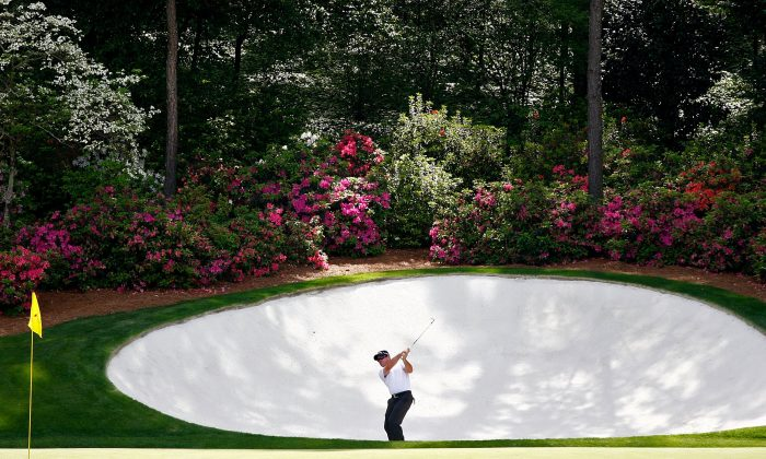 Bubba Watson plays a shot out of a bunker during the first round of the 2008 Masters Tournament at Augusta National Golf Club in Augusta, Georgia. (Jamie Squire/Getty Images)