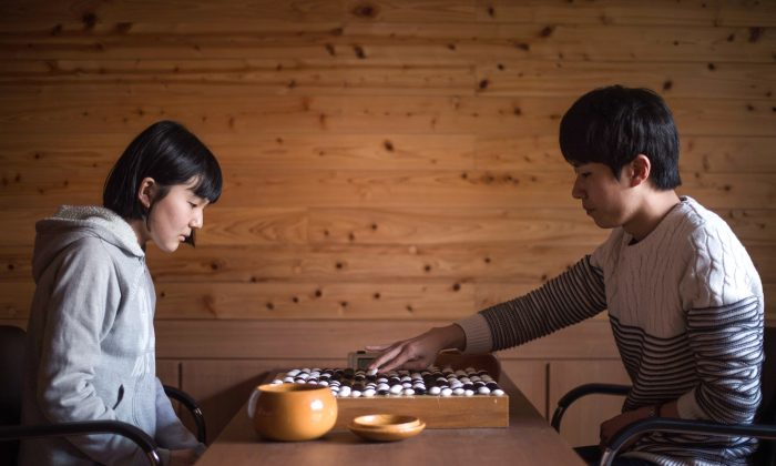 """Go"" teacher Jo Gyung-Ho (R) plays against Japanese student Mori Chisaki at the Lee Se-Dol School for ""Go"" in Seoul, Korea, on March 18.  (Ed Jones/AFP/Getty Images)"