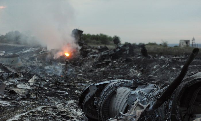 The wreckage of a malaysian airliner carrying 295 people from Amsterdam to Kuala Lumpur in Ukraine, on July 17, 2014. (DOMINIQUE FAGET/AFP/Getty Images)
