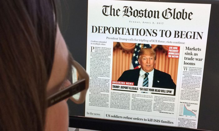 This April 10, 2016 photo taken in Washington shows a woman reading an online version of a mockup of what a frontpage might look like should Republican frontrunner Donald Trump win the presidency.    (Photo credit should read KAREN BLEIER/AFP/Getty Images)
