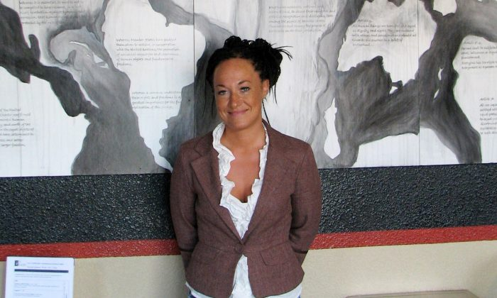 FILE - In this July 24, 2009, file photo, Rachel Dolezal, a leader of the Human Rights Education Institute, stands in front of a mural she painted at the institute's offices in Coeur d'Alene, Idaho. Dolezal, the former NAACP chapter president who made headlines in June when her race came into question. (AP Photo/Nicholas K. Geranios, File)