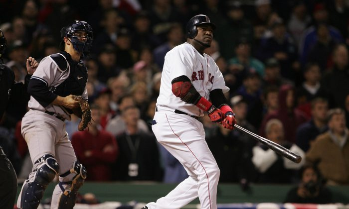 David Ortiz (R) had back-to-back walkoff hits in Games 4 and 5 of the 2004 ALCS to rally the Red Sox from an 0–3 deficit against the New York Yankees and into the World Series. (Doug Pensinger/Getty Images)