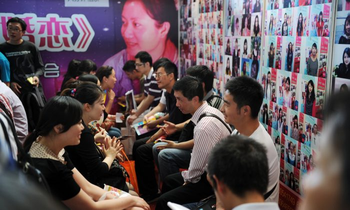 Visitors participate in speed dating at the second Shanghai Marriage Expo in Shanghai on May 27, 2012. (Peter Parks/AFP/Getty Images)