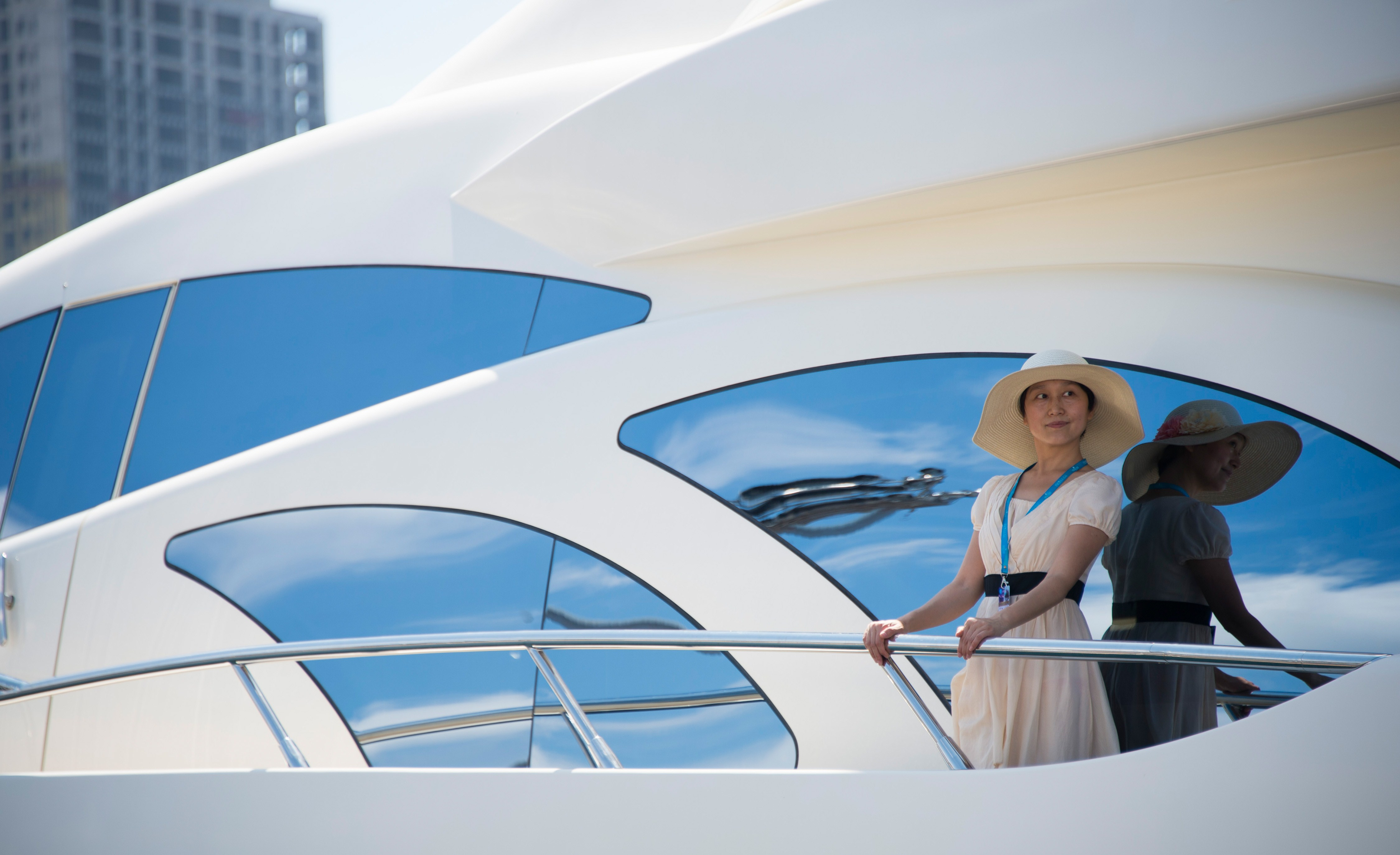 A woman on a luxury yacht at a boat show at the port in the northeastern Chinese city of Dalian on July 5, 2014. Chinese buyers are being targeted by the world's yacht builders, whose vessels can cost as much as 100 million USD. (JOHANNES EISELE/AFP/Getty Images)