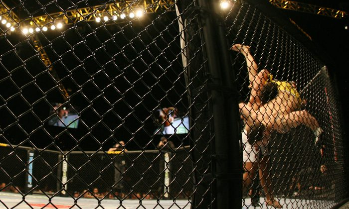 Franck 'The Answer' Edgar (R) fights with Tyson Griffin during UFC 67 at the Mandalay Bay Hotel in Las Vegas, Nevada on February 4, 2007. Started in 1993, the Ultimate Fighting Competition (UFC) is a combination of martial arts and boxing. (Gabriel Bouys/AFP/Getty Images)