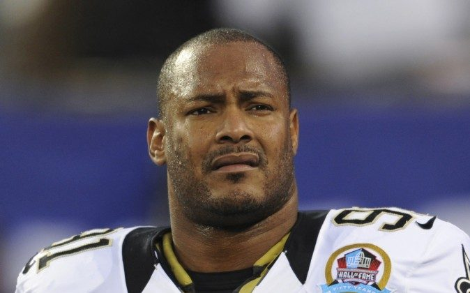 In this Dec. 9, 2012, file photo, New Orleans Saints defensive end Will Smith appears before an NFL football game against the New York Giants in East Rutherford, N.J. Smith was fatally shot after a traffic accident in New Orleans. (AP Photo/Bill Kostroun, File)
