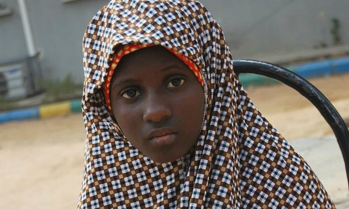 Wednesday Dec. 24, 2014 file photo, shows Zahra'u Babangida, a 13 year-old girl arrested with explosives strapped to her body in Kano Nigeria. The number of child bombers used by the Islamic extremists of Boko Haram has increased 10-fold in a year. (AP Photo/File)